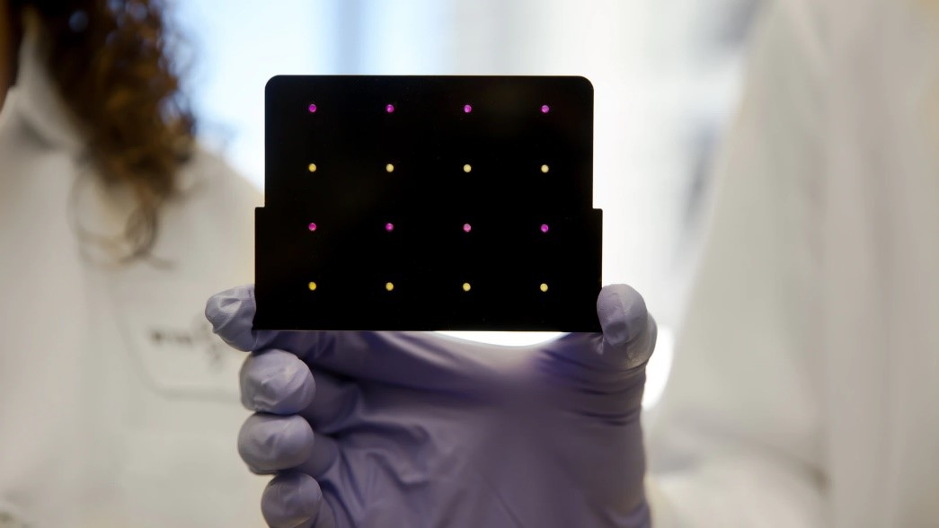 black patch with embedded sensors that emit red and yellow light