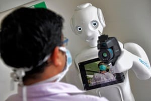 Healthcare worker interacts with person on robot's screen