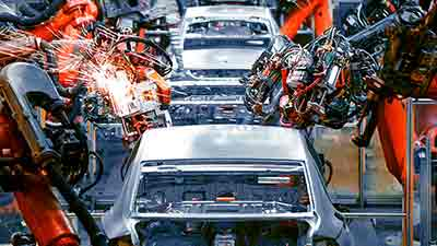 automobiles and robots on manufacturing floor