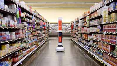 Robot in the middle of a grocery aisle