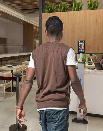 AI technology screens the temperature of man entering dining area