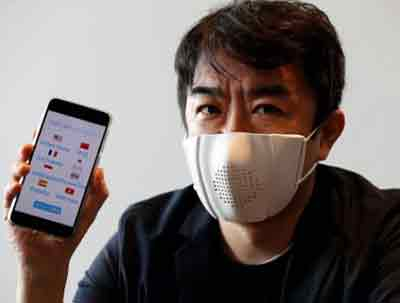 man wearing mask shows mobile app screen with speech translation tools