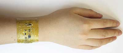 hand with strip of electronic skin packed with sensors