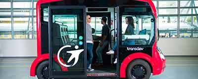 Red self-driving system transporting passengers