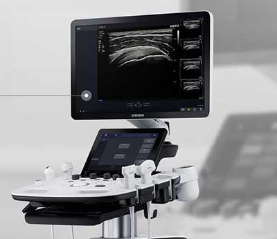Portable medical diagnostic tool showing patient images on screen