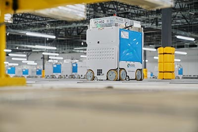 White and blue boxes on warehouse floor