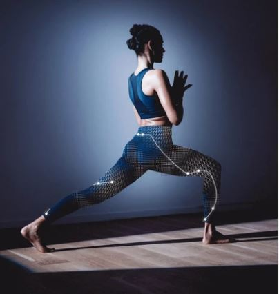 woman doing yoga pose in smart garments with sensors